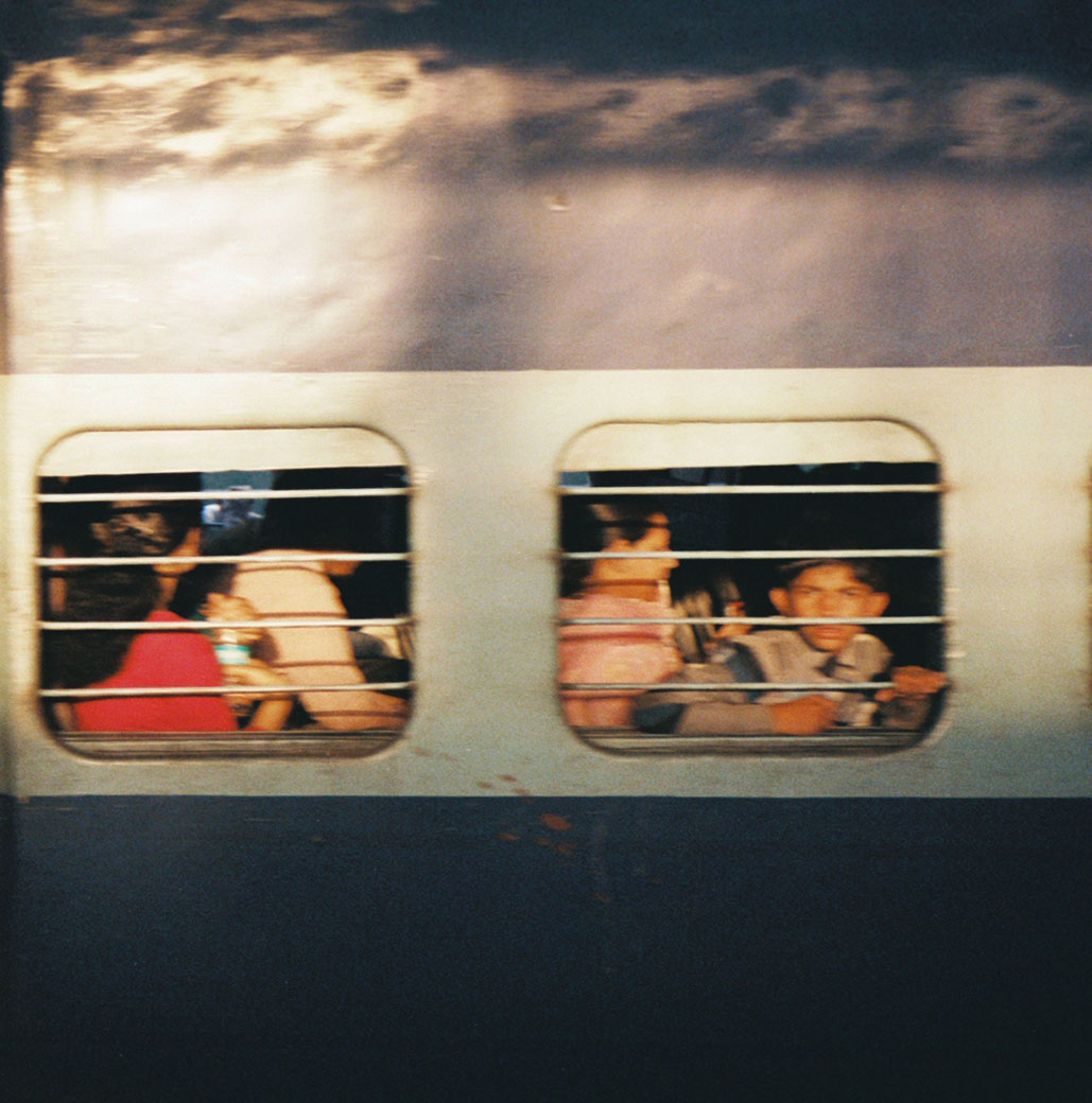 kid_in_train_window_blur_delhi_march_2013